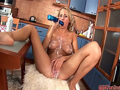 Watch Amelie Doll taking off her waitress outfit and showing off her big round tits and pouring whipped cream all over them before masturbating with a dildo.