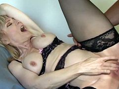 Lustful blonde milf Nina Hartley, wearing stockings and a bra, calls her neighbour to play dirty games. She favours the dude with a blowjob and allows him to fuck her snatch in the missionary and other poses.