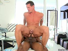 Horny black homosexual called Izzy lets his buddy play with his massive wang. After that they have sex in the reverse cowboy pose and doggy style.