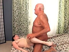 Slutty brunette Gia Maria Katte, wearing jeans, shows her big natural boobs to an old nerd. Then she gives hand to the guy and takes a ride on his cock.