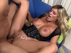 Click to watch this blonde pornstar, with big fake knockers and a shaved pussy, while she goes really hardcore with a big black prick.