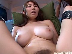 The gorgeous Asian babe Azumi Kinoshit gobbles a hard cock and ends up taking a hard fuck up her sweet hairy pussy on the couch.