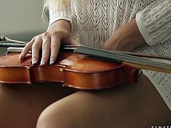 Libidinous babe playing violin and masturbating her pussy