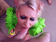 Masked blonde unpins her attire before sucking some balls as her ass is being licked till she is given a facial cumshot in a threesome
