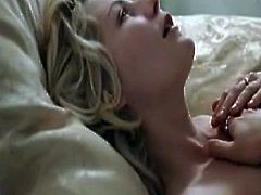 Kirsten Dunst shown from backside as she raises her arms and has some people help her pull her  off, revealing her bare ass. Then Kirsten Dunst waking up inside bed, wearing the see-through thin white shirt this reveals her left nipple when she sits up. Then Kirsten Dunst lying onto the sofa naked, exhibiting her bare leg but covering her hooters surrounding the fan as the male approaches her. From Marie Antoinette.