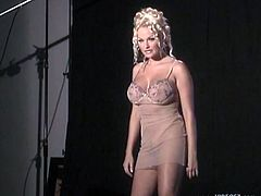 Take a look at this gorgeous blonde MILF backstage before getting in front of the camera and stripping off her sexy dress to show her perfect ass.