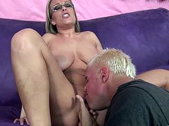 Take a nice look at this blonde cougar, with enormous gazongas and a shaved pussy, while she gets fucked hard by Porno Star over a couch.