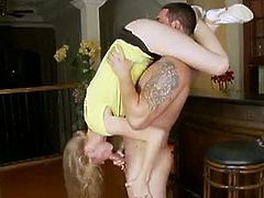 Avril Hall is a blonde teen. She's slim and light, so this guy holds her upside down and has her suck his cock. Next, he bangs her while holding her in his arms.