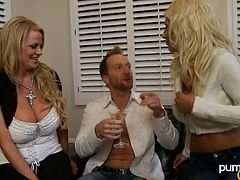 Check out this amazing hardcore scene where these beautiful blondes have a great time sharing a guy's big cock in a threesome.