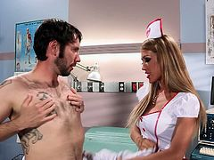 Blonde Capri Cavanni looks blazing hot in the uniform. You can see her huge tits bulging on her chest. She wasn't having sex for 3 months and she is so horny she had quickie sex with her patient in the diagnostic room.