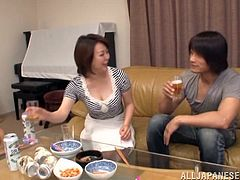 Take a look at this hardcore scene where this horny mature Asian sucks on a stud's hard cock before riding him in her living room.