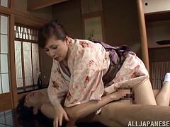 Prepare your cock for this Japanese MILF, with a nice ass wearing socks, while she goes really hardcore and moans like a naughty cougar.
