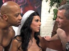 Lou Charmelle's honeymoon is about to get bigger and blacker. She start to blow this huge dong, before getting banged in front of her helpless husband! What a slut!