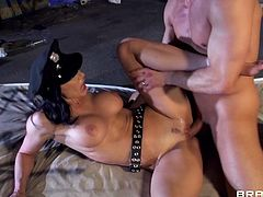 A very sexy cougar with long dark hair, huge fake tits and an awesome body enjoys getting her shaved pussy and asshole licked.