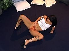 Horny brunette Christina Bella, wearing thong, is playing with her coochie indoors. She rubs her clit ardently, then smashes her pink cave with a dildo.
