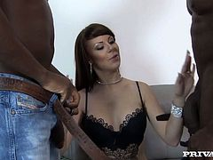 Take a look at this hardcore scene where the sexy milf Ambre Aphrodite is fucked by two big black cocks in a threesome until they cum inside her. Watch her husband licking cum out of her cunt.