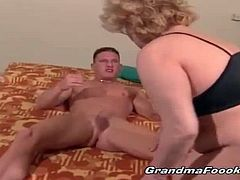 This lustful granny is lucky to get a fresh meat deep in her holes. She gobbles on this young stud's cock before he rams her hairy cunt. She could go on forever.