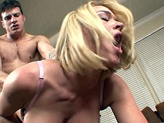Big-breasted blonde Krissy Lynn licks her man's shaft and lets him eat her smooth coochie. After that they have sex in the side-by-side position.