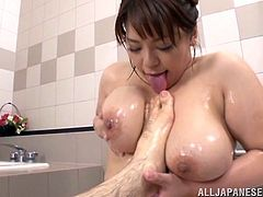 Chubby and big-breasted Japanese milf Mizuki Ann is having fun with a guy in a bathroom. She lets the dude soap and oil her big natural boobs, after that they bang in the cowgirl pose.