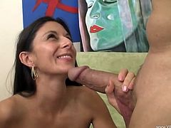 The sexy brunette MILF Nikki Daniels gives this guy an amazing handjob while she licks his balls and ends up getting rammed.