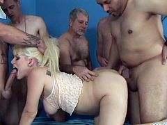 Beautiful pregnant blonde Barbie Summer masturbates her pussy with a dildo. After that she sucks the cocks of a few men and lets the guys fuck her twat doggy style.