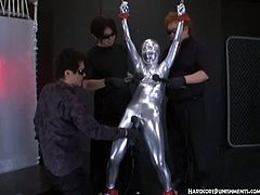 Helpless asian chick is full body wrapped with a weird silversuit and got exploited by her three horny masters played her nipples and her pussy with extreme vibrators
