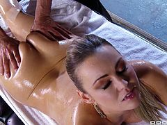 Busty blonde Abbey Brooks lets Toni Ribas oil and massage her body. After that Abbey takes Toni's schlong in her cunt and they have sex in the cowgirl pose.