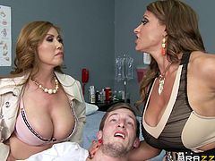 This unfortunate patient is about to have a big change in his case. Kianna and Eva are taking care of him, and they start by unleashing their massive melons for him to suck on. They start sucking him as well, and offer their ample jugs as well for a great titjob. What a lucky stiff!