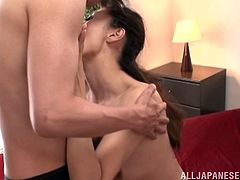 Slim Japanese milf, wearing thong, lets a guy lick her natural tits and pussy. After that they fuck in the missionary pose and doggy style and the bitch moans loudly with pleasure.