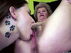 Take a look at this hot lesbian scene where this horny babe and kinky granny have a great time eating one another out.