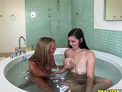 Chris and Jessica are two hot babes with some really big natural boobs. Chris feels the need of squishing with her friend's tits. They both got naked in the shower where they start rubbing their big sexy nipples. With those amazing wet bodies make their friend's dick get really hard so he joins her in the bath tub.