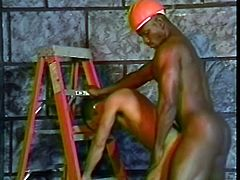 While the rest of the construction crew is still at work, these two black studs strip down and fuck each other there on the work site.