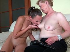 Click to watch this old woman, with natural breasts and a hairy pussy, while she goes hardcore in a FFM after having a lesbian moment with a doll.