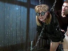 This dirty blonde slut is tied up in the dungeon by her mean master. The master is dominant and cruel and he shows her how to take pain. she is hanging and has her eyes covered. The sweet and innocent slave gets whipped and choked.