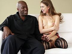 Get a boner by watching this brunette doll, with small boobs wearing nylon stockings, while she acts naughty next to a black fellow.