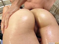 Slutty cowgirl Sheena Ryder, wearing a hat and shorts, shows her caboose to Jordan Ash and lets him drive his boner in her bumhole. They have anal sex in the cowgirl and other poses and don't want to stop.