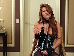 Sexy Asian chick Charmane Star, wearing a corset and stockings, is having fun indoors. She spreads her legs wide open and masturbates her shaved pussy with a dildo.