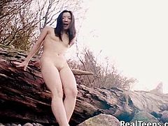 The horny Japanese babe Almond will get you really horny as she strips down to nothing and shows her hot ass and her yummy pussy outdoors.