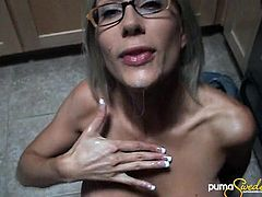 Lovely nude MILF in glasses with sexy tits giving a terrific blowjob then a handjob till she gets a facial cumshot and swallows the cum