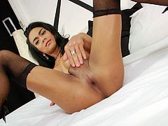 Click to watch this brunette ladyboy, with big tits wearing fishnet stockings, while she uses her hands to give pleasure to herself.