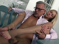 Things get hot in the kitchen when this sexy younger babe shows her love for older men when she gives him a blowjob and footjob.