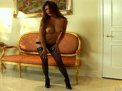Charmane gets so horny in her leather panties and fishnet stockings that she can't top masturbating as she poses on the couch.