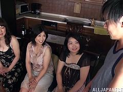 This group of horny Japanese MILFs jerk these guys off then let the guy's finger and fuck their naturally hairy pussies.