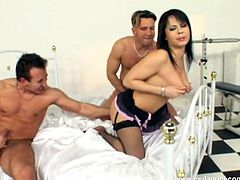 Check out this hardcore scene where this sexy brunette ends up with her big tits covered by semen after being drilled in a hot threesome.
