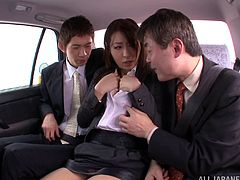 Watch this horny Asian slut having a threesome with two guys in a the backseat of a car as you jerk off and bust a nut.