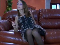 Lovely brunette Isabel A opens up her husband's present. She used this glass dildo as a temporary pleasure for her when her hubby is overseas. Look at her having fun on it.