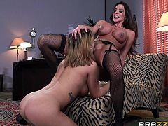 Salacious lesbians Ariella Ferrera and Keisha Grey are having a good time together. They lick and finger each other's cunts, then fuck them with a strapon.
