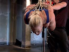Our Angel is a cheap whore that deserves to be humiliated. We hanged her above the floor and plaid with her ass, making sure she receives all the pleasure and pain she needs. After a while we decided to get rough with her and hanged her upside down. with her tits tied tight with rope. Curious what's next?