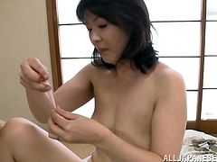 Hitomi Enjou is getting served with a young stud for a hot and hardcore fucking action. She gives the hot cock a blowjob and she gets a doggystyle fuck.