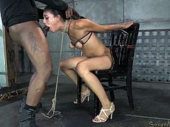 This bitch is in serious trouble! Not only that she is tied hard on that chair, completely naked and powerless, but she has two executors with hard dicks that want to give her ass a lesson. The white one goes first, stuffing her throat followed by the black guy. Then, she's bent over and ass pounded!